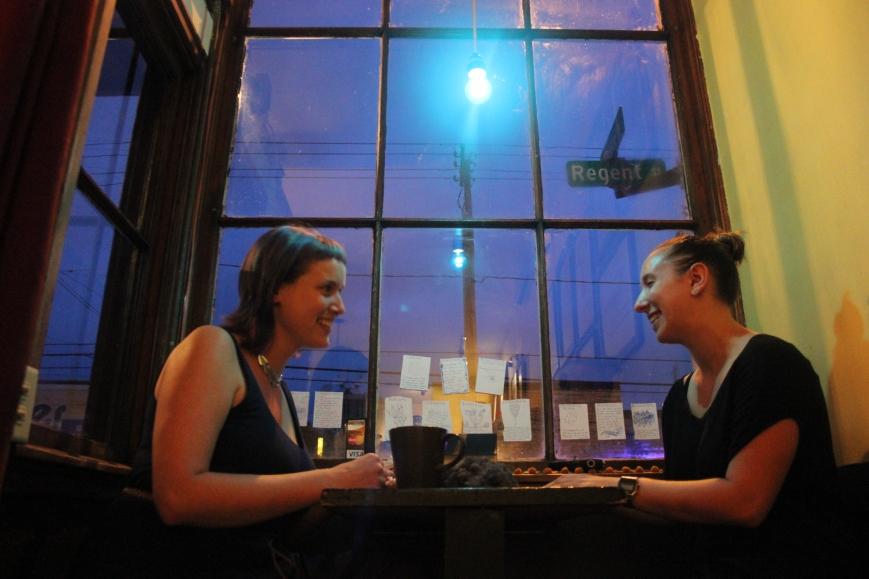 Katie Schag performing at Indie Coffee overlooking Regent St.